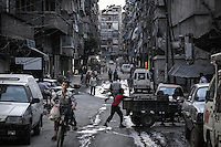 A busy street is seen at the dusk at one rebel controlled area in the Bustan Al-Qasr neighbourhood of Aleppo, the Syrian larger city.