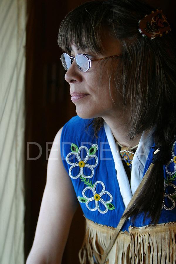 Maureen Vittrekwa wears her handmade caribou skin necklace and vest in Old Crow, Yukon Territory, Canada.