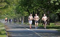 Young men jog along the coastal path enjoying the sunshine in Swansea, Wales, UK Friday 13 May 2016