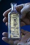 Author Fred Holabird talks about antique drug store bottles that he's found around the state, including this one from approximately 1909-1910. Holabird, who just released his second volume of his The Nevada Bottle Book series, talks in his office in Reno, Nev. on Tuesday, Feb. 14, 2017. (Cathleen Allison/Las Vegas Review-Journal)