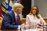 U.S. First Lady Melania Trump speaks during an opioid round table at the White House in Washington, DC, USA, 12 June  2019. At left is U.S. President Donald Trump.<br /> Credit: Zach Gibson / Pool via CNP/AdMedia