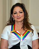 Gloria Estefan, one of he five recipients of the 40th Annual Kennedy Center Honors with her award as he poses for a group photo following a dinner hosted by United States Secretary of State Rex Tillerson in their honor at the US Department of State in Washington, D.C. on Saturday, December 2, 2017. The 2017 honorees are: American dancer and choreographer Carmen de Lavallade; Cuban American singer-songwriter and actress Gloria Estefan; American hip hop artist and entertainment icon LL COOL J; American television writer and producer Norman Lear; and American musician and record producer Lionel Richie.  <br /> Credit: Ron Sachs / Pool via CNP