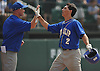 Jake Guercio #2, West Islip centerfielder, right, gets congratulated after crossing home plate in the top of the first inning in the Class AA varsity baseball Long Island Championship against East Meadow at Farmingdale State College on Saturday, June 4, 2016.