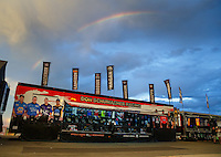 Jul 23, 2016; Morrison, CO, USA; A rainbow is visible over the merchandise trailer for NHRA team Don Schumacher Racing during qualifying for the Mile High Nationals at Bandimere Speedway. Mandatory Credit: Mark J. Rebilas-USA TODAY Sports