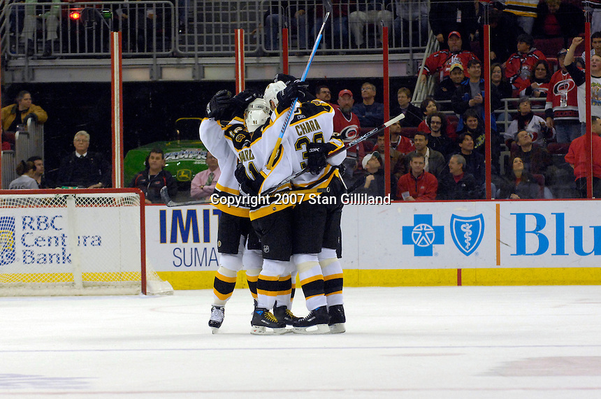 Boston Bruins' Zdeno Chara (33) celebrates his game winning goal against the Carolina Hurricanes with teammates including Marc Savard (91) Saturday, Feb. 3, 2007 at the RBC Center in Raleigh. Boston won 4-3 in overtime.