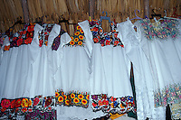 Mayan embroidered dresses for sale in the handicrafts market in Puerto Morelos, Quintana Roo, Mexico