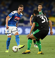 25th July 2020; Stadio San Paolo, Naples, Campania, Italy; Serie A Football, Napoli versus Sassuolo; Arkadiusz Milik of Napoli passes across the challenge from Gian Marco Ferrari