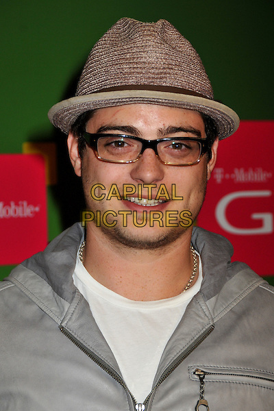 ANDREW LAWRENCE .T-Mobile's G1 Launch Party at Siren Studios, Hollywood, California, USA..October 17th, 2008.headshot portrait brown hat glasses stubble facial hair .CAP/ADM/BP.©Byron Purvis/AdMedia/Capital Pictures.