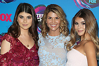 ***FILE PHOTO*** Lori Loughlin and husband, Mossimo Giannulli, will plead guilty to conspiracy charges in connection with securing  fraudulent admission of their two daughters.<br /> <br /> LOS ANGELES, CA - AUGUST 13: Isabella Giannulli, Lori Loughlin and Olivia Jade, at the Teen Choice Awards 2017 at Galen Center on August 13, 2017 in Los Angeles, California. <br /> CAP/MPI/DE<br /> ©DE//MPI/Capital Pictures<br /> CAP/MPIFS<br /> ©MPIFS/Capital Pictures