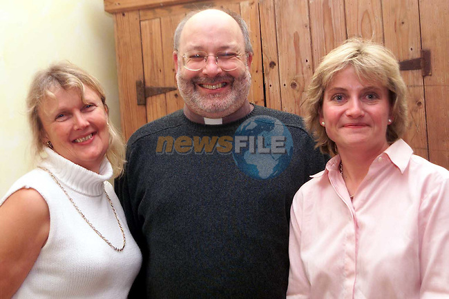 Lizanne Allen, Rev. Michael Graham and Pam Bagnall at the Christmas Craft Fair for St. Peter's Church of Ireland in Dardistown Castle..Picture: Paul Mohan/Newsfile