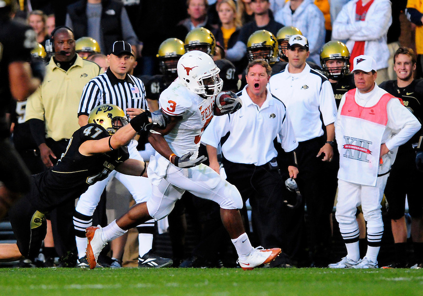 04 October 2008: Texas tailback Chris Ogbonnaya rushes against Colorado as Colorado personnel on the sideline react. Tackling Ogbonnaya is Colorado linebacker Shaun Mohler.  The Texas Longhorns defeated the Colorado Buffaloes 38-14 at Folsom Field in Boulder, Colorado. For Editorial Use Only