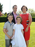 Libby Svejdar from LeCheile school who received her first holy communion at the Star of the Sea church Mornington pictured with parents Nick and Aileen and brother Harry. Photo: Colin Bell/pressphotos.ie