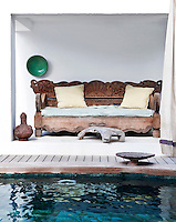 A Balinese daybed overlooks the swimming pool