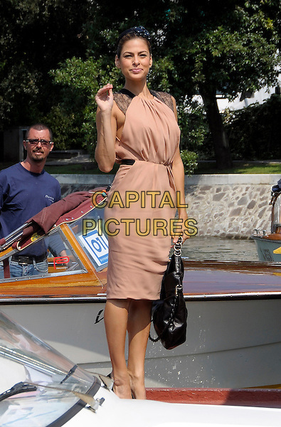 EVA MENDES .Arrival at the Hotel Excelsior, 66th Venice Film Festival, Venice, Italy..September 3rd, 2009.full length mendez beige pink dress sleeveless black lace hand waving bag purse .CAP/RD.©Richard Dean/Capital Pictures.