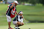 DES MOINES, IA - AUGUST 20: USA's Lizette Salas looks over her putt with her caddie Benito Olguin on the 9th hole during her singles match Sunday morning at the 2017 Solheim Cup in Des Moines, IA. (Photo by Dave Eggen/Inertia)