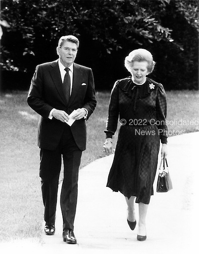 Washington, DC - (FILE) -- United States President Ronald Reagan walks Prime Minister Margaret Thatcher of Great Britain  to her car following a meeting that lasted over an hour in the Oval Office of the White House in Washington, D.C. on Wednesday, June 23, 1982..Credit: Howard L. Sachs / CNP