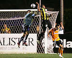 28 March 2007: Charleston's Newton Sterling (19) heads the ball over Houston goalkeeper Zach Wells (left) for the tying goal, scored in the 83rd minute. The Houston Dynamo tied the Charleston Battery 1-1 at Blackbaud Stadium in Charleston, South Carolina in a Carolina Challenge Cup preseason match.