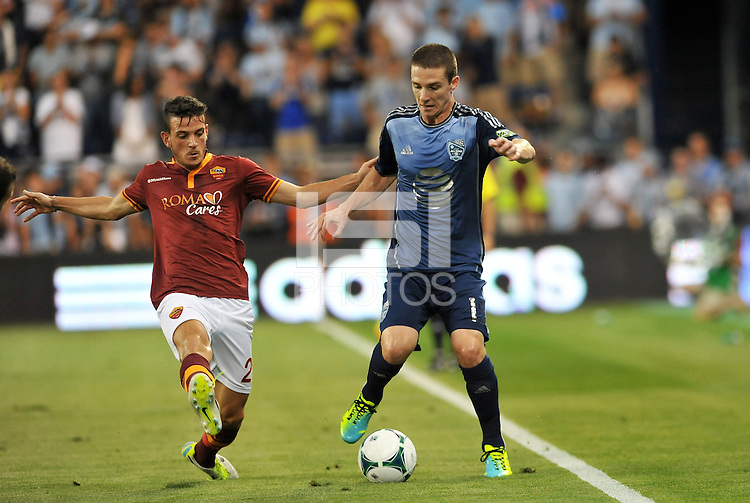 Sporting Park, Kansas City, Kansas, July 31 2013:<br /> Alessandro Florenzi (24) midfield AS Roma, Will Johnson (15) midfield MLS All-Stars .<br /> MLS All-Stars were defeated 3-1 by AS Roma at Sporting Park, Kansas City, KS in the 2013 AT &amp; T All-Star game.