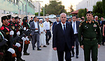 Palestinian Prime Minister Rami Hamdallah reviews the honor guards as he arrives to breakfasting with security forces on the Muslim holy fasting month of Ramadan, in the West Bank city of Jenin on June 18, 2017. Photo by Prime Minister Office