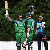 Cricket - ODI Summer Tri-Series - Scotland V Ireland at Grange CC - Edinburgh - Ireland batsman Paul Stirling celebrates his century (83 balls incl 5 sixes) on his way to making 133. Non-striking batsman Alex Cusack went on to make 71 - Picture by Donald MacLeod - 12.07.11 - 07702 319 738 - www.donald-macleod.com
