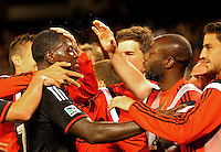 WASHINGTON, D.C - May 17 2014: Eddie Johnson  congratulated after scoring for United during D.C. United vs the Montreal Impact MLS match at RFK Stadium, in Washington D.C. The game ended in a 1-1 tie.
