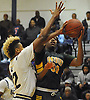 Darius Young #30 of Westbury, right, looks to drive to the net during a Nassau County varsity boys basketball game against host Baldwin High School on Tuesday, Jan. 17, 2017. Westbury won by a score of 63-57.