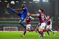 Sol Bamba of Cardiff City plays the ball over his head into the penalty area under pressure from Mile Jedinak of Aston Villa during the Sky Bet Championship match between Aston Villa and Cardiff City at Villa Park, Birmingham, England on 10 April 2018. Photo by Mark  Hawkins / PRiME Media Images.