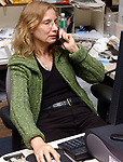 Karen Wiles-Stabile on the Photo Desk in Cityroom of Newsday in Melville on Friday October 14, 2005. (Newsday Photo / Jim Peppler).