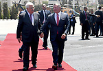 Jordan's King Abdullah II and Palestinian president Mahmud Abbas observes the honor guard during a visit in the West Bank city of Ramallah on August 7, 2017. Jordan's King began a rare visit to the occupied West Bank to meet With Palestinain president, amid shared tensions with Israel over a flashpoint Jerusalem holy site. Photo by Osama Falah