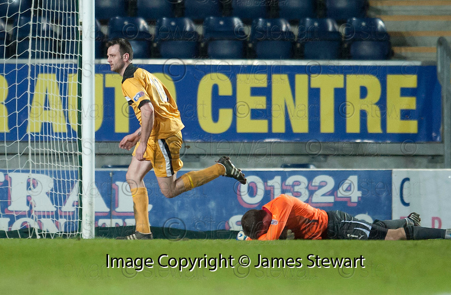 Dumbarton's Garry Fleming celebrates after he scores their third goal.