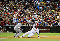 Jul. 6, 2012; Phoenix, AZ, USA: Arizona Diamondbacks fans cheer as outfielder Justin Upton slides into third base after hitting a two run triple in the sixth inning against the Los Angeles Dodgers at Chase Field. Mandatory Credit: Mark J. Rebilas-