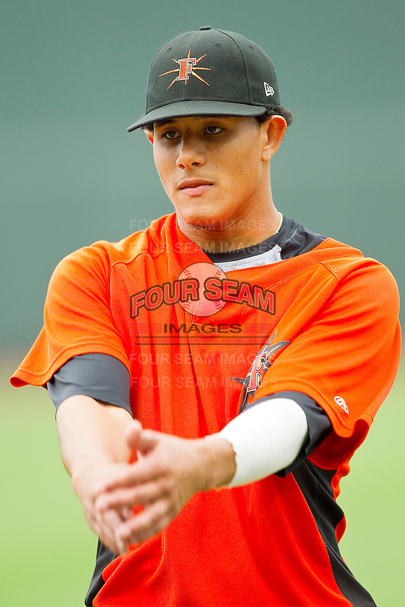 Manny Machado #3 of the Frederick Keys stretches prior to the game against the Winston-Salem Dash at BB&T Ballpark on August 5, 2011 in Winston-Salem, North Carolina.  The Dash defeated the Keys 10-0.   Brian Westerholt / Four Seam Images