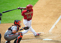 Apr. 8, 2012; Phoenix, AZ, USA; Arizona Diamondbacks third baseman Ryan Roberts hits a two run home run in the sixth inning against the San Francisco Giants at Chase Field. Mandatory Credit: Mark J. Rebilas-