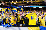Solna 2014-10-09 Fotboll EM-kval , Sverige - Ryssland :  <br /> Sveriges supportrar jublar och h&aring;ller upp en matchtr&ouml;ja med nummer 10 och tryck Kennedy under matchen mellan Sverige och Ryssland<br /> (Photo: Kenta J&ouml;nsson) Keywords:  Sweden Sverige Friends Arena EM Kval EM-kval UEFA Euro European 2016 Qualifier Qualifiers Qualifying Group Grupp G Ryssland Russia supporter fans publik supporters