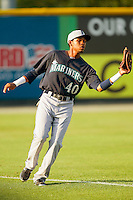 Pulaski Mariners left fielder Jesus Ugueto (40) catches a fly ball during the Appalachian League game against the Burlington Royals at Burlington Athletic Park on June20 2013 in Burlington, North Carolina.  The Royals defeated the Mariners 2-1 in 13 innings.  (Brian Westerholt/Four Seam Images)