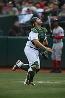OAKLAND, CA - APRIL 4:  Josh Phegley #19 of the Oakland Athletics chases a foul ball against the Boston Red Sox during the game at the Oakland Coliseum on Thursday, April 4, 2019 in Oakland, California. (Photo by Brad Mangin)