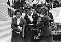 Mrs. Janie Green, right, is assisted by a friend at the funeral for her son, William Barrett, the 27th victim in a string of murders of young African-Americans in Atlanta on Saturday, May 16, 1981. (AP Photo/Gary Gardiner)