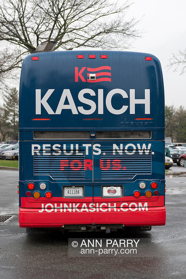 """Hempstead, New York, USA. April 4, 2016. The John Kasich Campaign Bus, with slogan """"RESULTS. NOW. FOR US.' on rear, is leaving rainy campus, after the Republican presidential candidate and governor of Ohio, hosted a Town Hall at Hofstra University David Mack Student Center in Long Island. The New York primary is April 19, and Kasich is the first of the three GOP presidential candidates to campaign in Nassau and Suffolk Counties, and is in third place in number of delegates won."""
