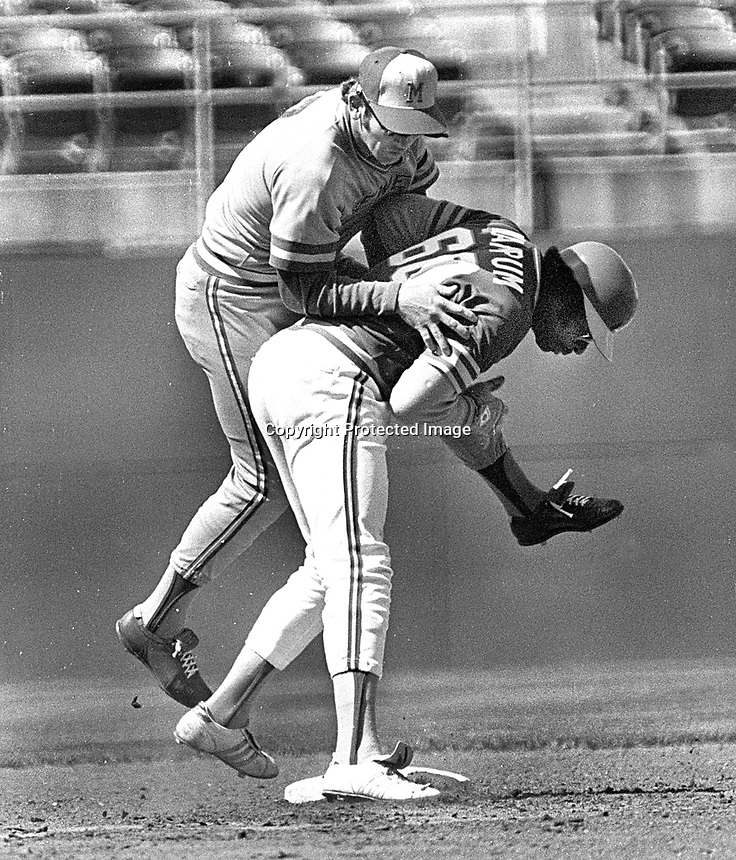 Oakland Athletics Dick Allen,upending Milwaukee Brewers.. #7 Don Money........(1977 photo/Ron Riesterer)