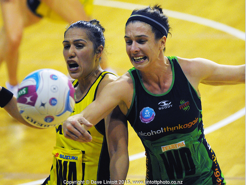 Ash Brazill tries to intercept a pass to Liana Leota (left) during the ANZ Netball Championship match between the Central Pulse and West Coast Fever at TSB Bank Arena, Wellington, New Zealand on Sunday, 19 April 2015. Photo: Dave Lintott / lintottphoto.co.nz
