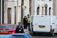 Tuesday 18 February 2014<br /> Pictured: Police Stand outside a terraced house  at New Road Pontyberem<br /> Re: It is beleived that a baby has been killed by a dog at an address in New Road, Pontyberem, Carmarthenshire, Wales, UK