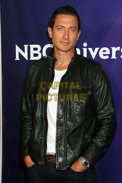 Sasha Roiz .NBC Universal 2013 Winter Press Tour - Day 1 held at the Langham Huntington Hotel & Spa, Pasadena, California, USA..January 6th, 2013.half length black white top leather jacket     .CAP/ADM/BP.©Byron Purvis/AdMedia/Capital Pictures.