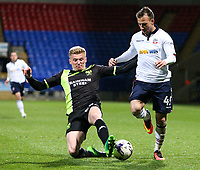Bolton Wanderers' Adam Le Fondre is tackled by Bury's Taylor Moore<br /> <br /> Photographer Alex Dodd/CameraSport<br /> <br /> The EFL Sky Bet League One - Bolton Wanderers v Bury - Tuesday 18th April 2017 - Macron Stadium - Bolton<br /> <br /> World Copyright &copy; 2017 CameraSport. All rights reserved. 43 Linden Ave. Countesthorpe. Leicester. England. LE8 5PG - Tel: +44 (0) 116 277 4147 - admin@camerasport.com - www.camerasport.com