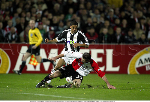 KIERON DYER is challenged by Brett Emerton, Feyenoord 2 v NEWCASTLE UNITED 3, UEFA Champions League First Group Stage, Group E, De Kuip 021113 Photo:Glyn Kirk/Action Plus...Soccer football 2002.tackle tackles.....