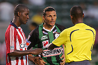 Santos defender Fernando Ortiz (3) exchanges words with ref Ricardo Morgan as Chivas USA defender Shavar Thomas (4) looks on. Chivas USA defeated the Santos of Laguna 1-0 during the 1st round of the 2008 SuperLiga at Home Depot Center stadium, in Carson, California on Wednesday, July 16, 2008.
