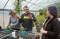 NWA Democrat-Gazette/BEN GOFF @NWABENGOFF<br /> Michele (CQ) Senlikci and husband Soner Senlikci of Fayeteville learn from Megan Lankford, Botanical Garden of the Ozarks horticulture supervisor, as they make their their potted arrangments Saturday, Jan. 12, 2019, during a 'Succulent Make and Take' class at Botanical Garden of the Ozarks in Fayetteville. Participants learned how to care for the water-conserving plants native to arid climates and made their own arrangement to take home.