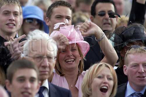 19 June 2004: Racegoers in the Silver Ring cheering on their horses at Royal Ascot. Photo: Martin Cushen/Action Plus...040619 horse racing fashion hat hats woman