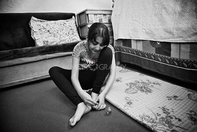4.4..2015, Kirkuk,Iraq:  Marta likes the colour pink and she usually polishes her nails with that.