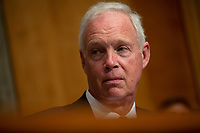 United States Senator Ron Johnson (Republican of Wisconsin) listens to Acting Commissioner of U.S. Customs and Border Protection Mark Morgan and Deputy Inspector General of U.S. Department of Homeland Security Jennifer Costello testify before the U.S. Senate Committee on Homeland Security on Capitol Hill in Washington D.C., U.S. on July 30, 2019. <br /> <br /> Credit: Stefani Reynolds / CNP/AdMedia
