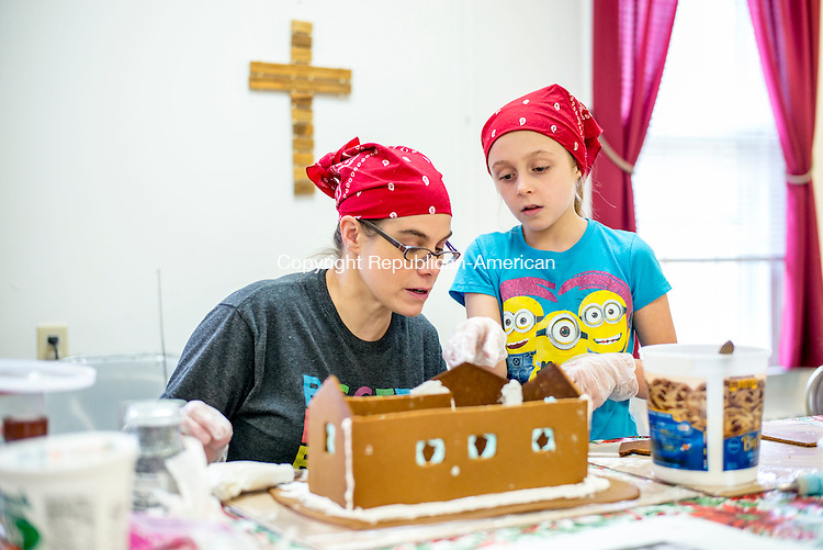 Middlebury, CT- 25 November 2016-112516CM03-  Kristine Boisits, left, and her daughter, Elizabeth, 8 of Middlebury, work on a gingerbread house at  St. George's Episcopal Church in Middlebury on Friday.  Volunteers were getting the houses ready for the annual gingerbread village, which opens on December 3rd.     Christopher Massa Republican-American